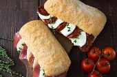 Assorted Sandwiches. Sandwich Caprese With Mozzarella And Sun-dried Tomatoes And Ciabatta With Ham poster