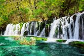 Waterfall And Azure Lake With Crystal Water Among Green Woods poster