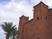 Moroccan Fortress With A Plam Tree, Ait Benhaddou Ksar, Ouarzazate, Morocco