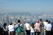 Tourists Sightseeing The Hong Kong Skyline