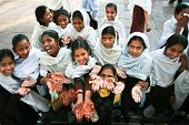 AGRA, INDIA - FEBRUARY 02: Indian girls with traditional  henna tattoo on hands, February 02, 2008 in Agra, India.
