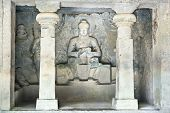 Stone sculptures in the  Ellora rock carved Buddhist temple, Aurangabad, Maharashtra, India