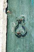 Old metal door handle mediterranean style on green door dated from 1788., Dubrovnik , Croatia