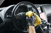 A Man Cleaning Car With Microfiber Cloth. Car Detailing. Valeting Concept. Selective Focus. Car Deta poster