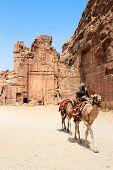 PETRA, JORDAN - SEP 25: Unidentified Bedouins provide tourist camel rides through the ruins of ancie