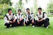 foto of tehran  - Traditional dressed iranian men posing in park - JPG