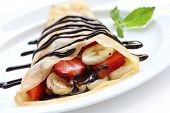 stock photo of crepes  - Strawberry Banana Crepe with Chocolate syrup - JPG