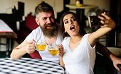 Couple Cheerful Mood Drinking Beer In Pub. Man Bearded Hipster And Girl With Beer Glass Full Of Craf poster