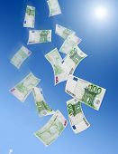 One hundred euro banknotes falling from the sky