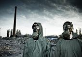 stock photo of breather  - Two man wearing gas masks after nuclear disaster - JPG