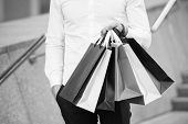 Bunch Of Shopping Bags In Male Hands Outdoor, Close Up. Shopping Tips. Successful Shopping Expeditio poster