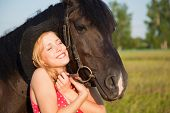 foto of beautiful horses  - Young blond woman in red dress  with horse - JPG
