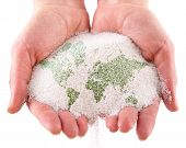 Sand with map of the world in the hands. Isolated on a white background