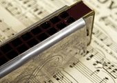 old harmonica on sheet music