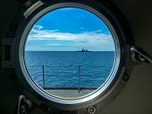 Window Port Of Navy Ship With Dogs For Locking The Window. Outside The Window Also Has Destroyer Sai poster