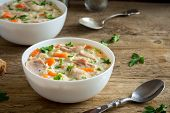 Chicken And Wild Rice Soup. Homemade Fresh Creamy Soup With Chicken, Vegetables And Wild Rice In Whi poster
