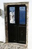 greek island door with stucco building santorini