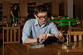 Brunette In Glasses At The Table With Books. Library With Green Lights On The Tables. An Old Library poster
