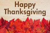 Happy Thanksgiving Greeting, Some Fall Leaves On Weathered Wood With Text Happy Thanksgiving poster