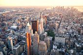 New York City Manhattan sunset skyline aerial view with office building skyscrapers and Hudson River