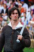 NEW YORK CITY - OCT 3: Swordsman dressed in medieval costume in New York Medieval Festival. October 3, 2010 in Ft. Tryon park; Manhattan, New York City.