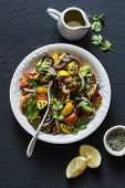 Roasted Eggplant, Sweet Tomato And Cilantro Mediterranean Style Salad On Dark Background, Top View.  poster