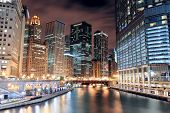 image of illinois  - Chicago River Walk with urban skyscrapers illuminated with lights and water reflection at night - JPG