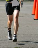 A runner competing in a race, waist down.