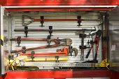 stock photo of fire truck  - Fire truck equipment in rack - JPG