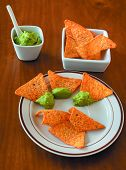 Triangles And Guacamole. Triangular Cookies Prepared To Spread With Guacamole. poster