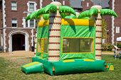 stock photo of bounce house  - A colorful big bounc house for kids to jump on in the  outdoors - JPG