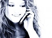 Beautiful Sixteen Year Old Teen Girl On Cellphone.  In blue tones.