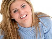 Beautiful Teen Girl Smiling Looking Upr. Shot in studio over white.