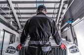 Car Mechanic Challenge. Caucasian Auto Service Worker Preparing For Challenging Work To Fix Broken V poster