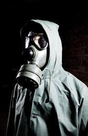 stock photo of s10  - Man wearing respirator or gas mask - JPG