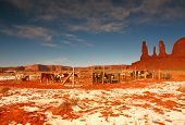 The Three Sisters Formation In Monument Valley Next To A Horse Stable poster