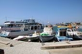 picture of larnaca  - Fishing and tourist pleasure boasts moored in Larnaca harbor Cyprus - JPG