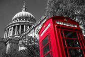 pic of church-of-england  - A red London phone box with a black and white St Paul - JPG