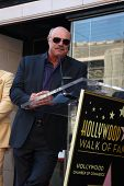 LOS ANGELES - MAY 13:  Dr. Phil McGraw at the Steve Harvey Hollywood Walk of Fame Star Ceremony at t