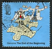 UK - CIRCA 2003: A stamp printed in UK shows image of the Completeing the Genome Jigsaw, 50th Anniversary of Discovery of DNA, circa 2003.