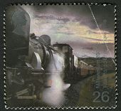 UK - CIRCA 2000: A stamp printed in UK shows image of the Garratt Steam Locomotive No. 143 pulling Train (Eheilffordd Eyri, Welsh Highland Railway), circa 2000.