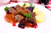 picture of deer meat  - Red deer goulash with potato Burgundy sauce and wild berries macro - JPG