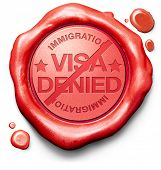 image of denied  - visa denied or rejected immigration stamp for crossing the border passing customs for tourism and passport control approval to enter country - JPG