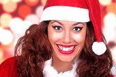 Beautiful Brunette Wearing Santa Claus