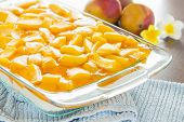 picture of jello  - Decadent cheesecake topped with fresh mango and orange jello with macadamia nut crust - JPG