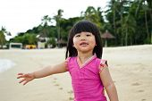 foto of curio  - Young toddler at the beach having fun and is curios - JPG