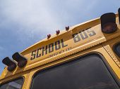 Detail of typical school bus signage in bright afternoon light.