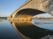 Dawn light on the Arlington bridge and Potomac river in Washington DC, USA.
