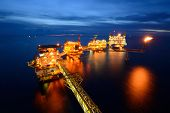 stock photo of pollution  - The large offshore oil rig at night with twilight background - JPG