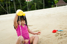 stock photo of curio  - Young toddler at the beach having fun and is curios - JPG
